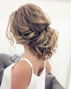 Beautiful messy updo wedding hairstyle for romantic brides