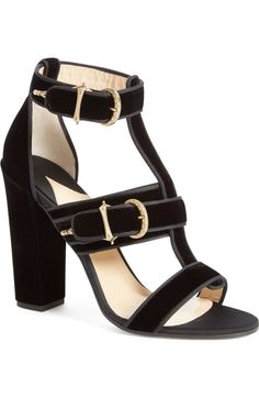 Head over heels for these lush velvet sandals with stunning gold buckles for a modern chic look.