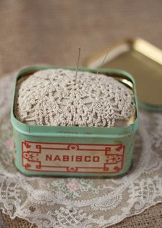 Reuse a tin that's lost its lid and pin needles to it