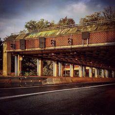 #traffic #driving #street #cars #city #road #bridge #underpass #concrete #sky #light #sundown #sunset #evening #summer #sonnenuntergang #sun #cockpit #car #carwindow #industrial #bricks #autobahn #highway