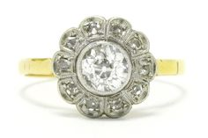 The Oakland antique Edwardian 1 carat diamond engagement ring is a delightful floral cluster dating to the early 1900s. Centered by a captivatingly brilliant old European cut brilliant encircled by a scalloped rose cut diamond halo kissed with dainty milgrain details. #diamond #platinum #engagementring #engagementrings #love #ido #engaged #sparkle #sparkles #diamonds #gold #18k #18kgold #antique #1900s #1900 #antiquering #antiquerings #heirloom #estatejewelry #estatejewelery #antiquejewelry Estate Engagement Ring, Antique Engagement Rings, Antique Rings, Diamond Engagement Rings, Antique Jewelry, 1 Carat, Rose Cut Diamond, Halo Diamond, Estate Jewelery