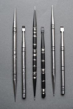 Steel Tools by Shanna Leino | Double-Ended Steel Awls and Micro Chisels showing 3 patterns: Hammered, Patterned, and Blackened.