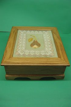 Hand made wooden box showing embroidery design