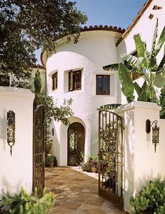 Love the entrance and the wrought iron.