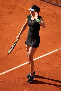 Ana Ivanovic Photos Photos - Ana Ivanovic of Serbia acknoweldges the crown after her Women's Singles match against Yaroslava Shvedova of Kazakhstan on day one of the 2015 French Open at Roland Garros on May 24, 2015 in Paris, France. - 2015 French Open - Day One