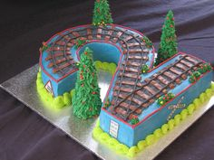 """This birthday train cake began as a 14 x 11 cake and was carved into a """"2."""" Brilliant!"""