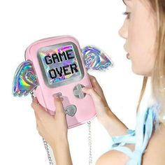 Game Over Hologram Purse. Game room. Gamer gifts. Gamer bedroom. Gamer girl and hipster girl. Gamer bag video games. Gamer bag products. Gamer girl. Anime love. Comic con costumes. Comic con outfit. Punk outfits. Punk aesthetic. Punk aesthetic girls. Pink punk aesthetic. Pink aesthetic. Pink aesthetic grunge.