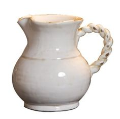 """Tuscany Collection Decorative Pitcher by Napa Home & Garden. $16.99. Twisted handle. Looks beautiful holding flowers or on its own. White glazed ceramic pottery. From Napa Home & Garden's Tuscany Collection. Decorative pitcher is 6.25 tall, 6"""" wide and 8"""" deep. Decorative Pitcher with twisted handle. 6.25"""" tall and 8"""" wide. Napa Home & Garden's Tuscany Collection features white glazed ceramic pottery that is a must-have for any lover of Italian pottery."""