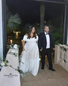 Plus size wedding gown with open shoulders and 3d flowers on a skirt