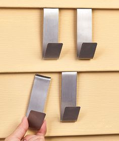 "Brick or Siding Clips | LTD Commodities An easy and simple way to decorate vinyl sided or brick walled homes. Set 4 Brick Clip Hooks (approx. 2-3/4"" x 1-1/2"" x 3/8"", each) can be used on brick walls and chimneys indoors and out. Install in seconds, supports up to 25 lbs per clip. Set 4 Siding Clips (approx. 4-1/8"" x 1-1/2"" x 1-1/4"", each) installs quickly and holds up to 12 lbs. per hook. No damage/holes! Easy reposition or removal."