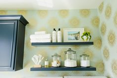 Floating+shelves+provide+handy+open+storage+in+this+transitional+laundry+room.+Glass+jars+house+detergent,+clothes+pins+and+other+essentials,+while+sunburst+wallpaper+adds+a+glam+touch+to+the+space.
