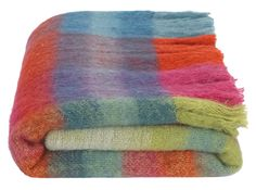 Lax mohair throw, £99 MADE.COM Textile artist and designer, Ptolemy Mann, is a colour pro. We're obsessed with her Pinterest. Her collection, Lax, features natural mohair in rich patterns and colours.