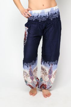 These gorgeous purple Elephant print harem pants come straight from the mountains of Northern Thailand. Symbolically capturing the nobility and extravagance of the elephant in vibrant patterns and colors, these stunning harem pants will surely stimulate strength as you move effortlessly through your Warrior pose.  With silky-soft elastic at the waistband and ankles, these specially made yoga pants provide the right combination of support and flexibility that every serious yoga lover craves.
