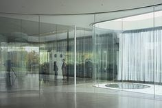 21st Century Museum of Contemporary Art, Kanazawa, Kazuyo Sejima (2004): In a word, transparency.  Much the same as Kuma's exploration of environment and building.  The use of glass blurs the lines between in and out.  Even in rooms further inside the building, there is a view of the outside through multiple layers of glass internal walls.