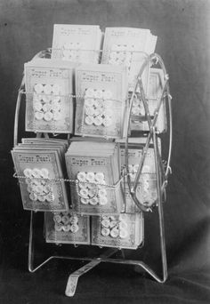 "Hawkeye Button Co., ""Ferris Wheel"" display Photographer Grossheim, Oscar Date Original July 15, 1907 Description A photograph of a display unit in the shape of a ferris wheel. There are pearl buttons sewn on cards in the wire display unit. The cards read ""Super Pearl"" across the top of the card. There are twelve buttons on each card."