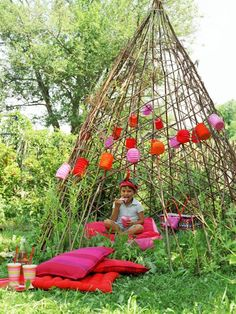 A colorful summer teepee creates a backyard summer playhouse for children to enjoy from spring through fall.