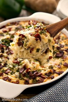 Loaded Mashed Potato Casserole - All the flavors of a loaded baked potato in casserole form! The ultimate comfort food!