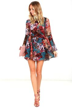 Whether you're the poet or the muse, you'll love the Inspire Me Teal Floral Print Long Sleeve Dress! Teal, purple, burgundy, blue, and taupe floral print mingles across woven poly as it falls from a mock neck, into a swing bodice with princess seams and flaring godets. Long bell sleeves. Hidden back zipper. As Seen On Olivia of @oliviarink!