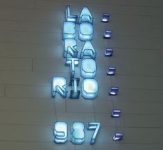 Lit exhibition signage for Laboratorio 987 MUSAC. Museo de Arte Contemporáneo. By Folch Studio. Light box type.
