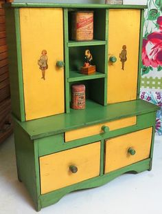 Child's stepback cupboard. Ca 1920.  I have a very similar colored one but it's narrower.  I have a little plastic meat grinder on the edge of the counter. Love it! Barb M.