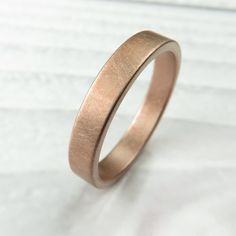 Brushed rose gold wedding band handmade by Spexton in 4MM width. Stronger than typical gold bands, this ring is seamless.