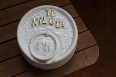 I found this gorgeous antique 10Kg weight, and could not resist making a plaster mold of it. The result is a mold made weight reproduction, glazed in