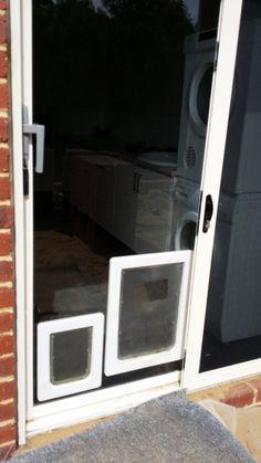 Double Glass Doors with Doggie Door * Click image for more details. #CatDoorsPensStep