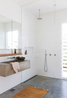With a flexible single-storey floor plan, this light and luxurious home on Sydney's northern beaches suits the needs of everyone in the family. Bathroom Concrete Floor, Concrete Floors, Bathroom Flooring, Wood Flooring, Plywood Floors, Stained Concrete, Bathroom Tapware, Concrete Furniture, Concrete Countertops