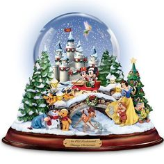 Snow Globe 'Musical Snowglobe - Mickey and Minnie, Winnie the Pooh, Tinker Bell and more, Lights up! Lanterns, tree and castle illuminate casting a warm glow on snow-blanketed holiday Disney scenes, A special snow-blowing mechanism swirls snow continuously around Tinker Bell and the Disney castle inside the water-filled globe...  #Christmas #Christmas2015