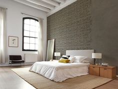 Old stucco wall with ornaments, rather cool! ;Available in two colours, warm grey/brown and pale blue.This wallpaper is printed on very high quality thick non woven wallpaper. Comes in rolls of 50 ;cm.