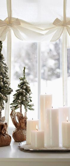 Why is it easier to decorate doors than windows for Christmas? Good thing Christmas window decor ideas like this exists. Simple and easy!  Hello White Christmas!