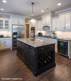 This spacious kitchen offers abundant work space with a center island. The Travis, home design #1350.