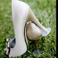 Mini plastic champagne flute bottoms for heels - makes an outdoor photo shoot much easier! No more sinking in the dirt!