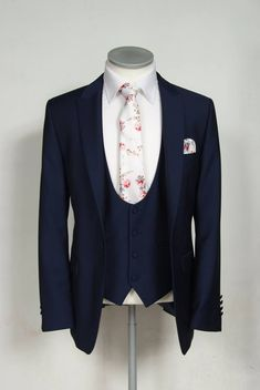 Slim Fit Navy Lounge Suit with matching scoop Waistcoat, Vintage Floral Tie with matching Pocket Square.