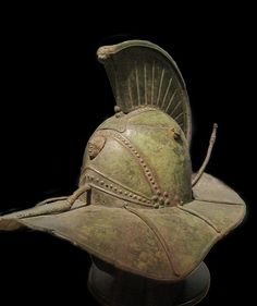 Rare fully intact Roman bronze gladiator helmet featuring the hero  Hercules on the front and the defeated Nemeian Lion on the base of the  comb.  Before 1st C. AD.  Higgins Armory Museum, Worcester, Massachusetts.