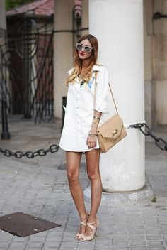 25 Shirtdress Outfit Ideas for Spring - classic white shirtdress worn with nude sunglasses, heels, and crossbody bag | StyleCaster