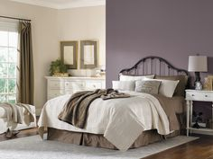 Sherwin-Williams Exclusive Plum: To keep the hue from feeling too heavy and somber, try pairing it with plenty of warm whites or creams. A wood floor also adds warmth and co...