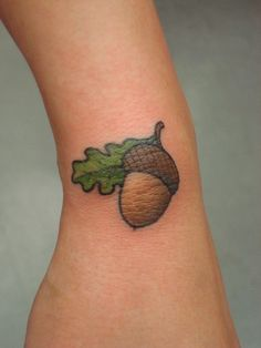 Cute acorn tattoo my son had a fit when he see this.  He has a thing about acorns.