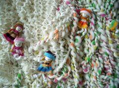 White Handspun Yarn with dolls by ginga squid.  So cute.  I wish I could make art yarn like this.
