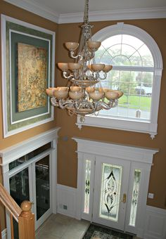 Revival_Door_and_Window_ Surround_with_Dentil_Crown_Molding_Foyer