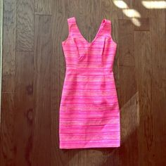 Lilly Pulitzer Dress This Lilly Pulitzer neon pink metallic laidley dress has only been worn 2 times! It is stunning and so perfect for the spring and summer time! Open to offers. Lilly Pulitzer Dresses Mini