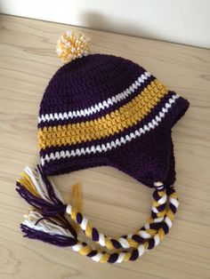 Great directions based on Repeatcrafterme's owl hat.  Can be adapted to Bronco's colors Sewing Barefoot: crocheted ravens hat