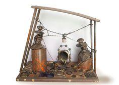12 Natività, tecnica mista metallo,vetro,legno penne biro, smalto) cm 55x63x33