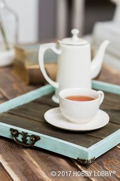Create home decor you love by turning framed wood paneling into a wooden tray with metal feet and handles!