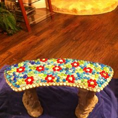 Used glass gems to mosaic my bench for the garden.