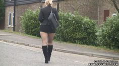 British secretary in short skirt, black pantyhose tights and boots walks to the office.