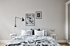 framed black and white photos in the bedroom