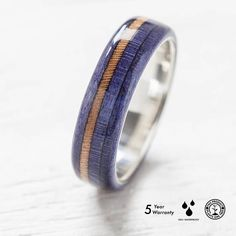 Handmade wooden ring made from broken skateboards with silver band inside - wooden box included. Like every skateboard, it contains 7 colorful layers of canadian maple - really hard wood. One layer - one color is ca. 1,4mm. Our rings are impregnated with the special waterproof cover which