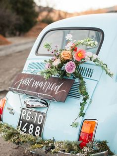 Perfect Pastel Wedding Details for a Spring Wedding | Vintage Getaway Car: Add this idea to your Pinterest wedding planning board, because this vintage getaway car is all kinds of chic! This classic Fiat 500 adorned with florals and calligraphy is seriously a wedding exit dream come true.