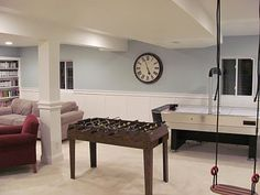 If we ever have a basement, love this look--wall color, wainscotting, and large clock in particular.